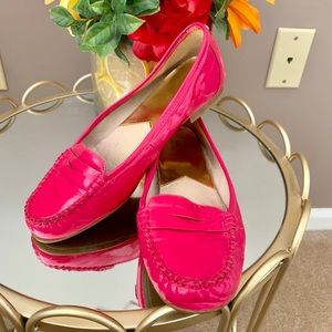 Michael Kors hot pink loafers.
